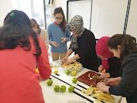 PREPARING FRUIT SALAD AND CAKE